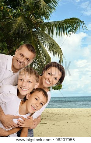 happy family at beach in summer