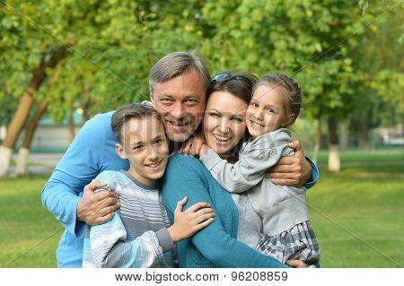 Family resting in  summer park