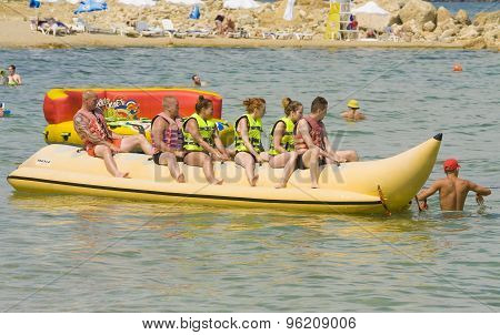 People On Inflatable Boat