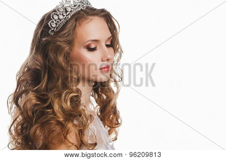 Portrait of young beautiful bride with stylish make-up and hairdo, isolated on white background