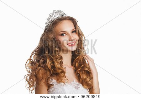 Portrait of young beautiful happy bride with stylish make-up and hairdo, over white background