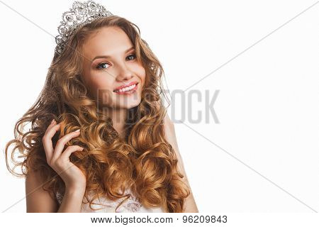 Portrait of young smiling beautiful bride with stylish make-up and hairdo, over white background