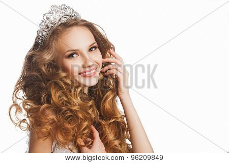 Portrait of young beautiful smiling happy bride with stylish make-up and hairdo, over white backgrou
