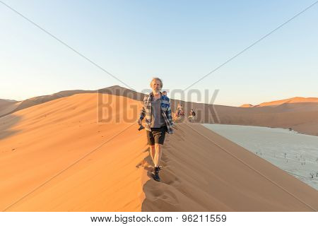 Early Morning Climbers On Sand Dune Near Sossusvlei, Namibia