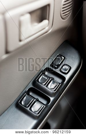 Car door with window control panel on it close-up