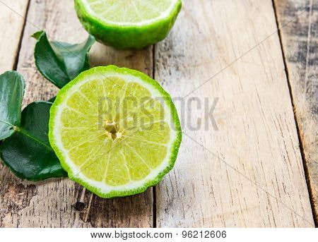 Bergamot On Wooden Table, (kaffir Lime)