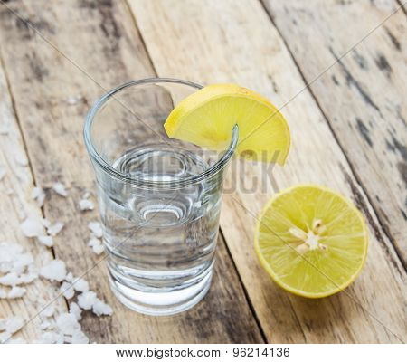 Vodka With Lemon On Wooden Background