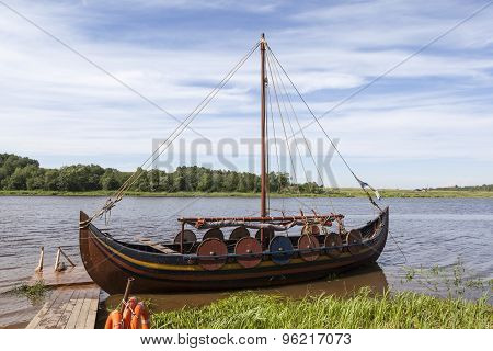 Boat on the river Volkhov at the festival, reconstruction of Ladoga Fest. Lyubsha. Russia.