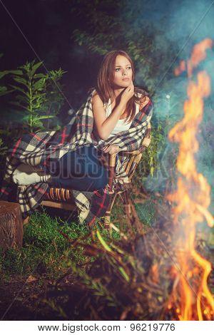 Pensive Girl Sitting Near Bonfire