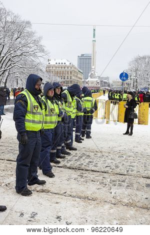 RIGA, LATVIA, MARCH 16, 2010: Local police guard cordon behind crowd control barriers at the Freedom Monument at the commemoration of the Latvian Waffen SS unit.
