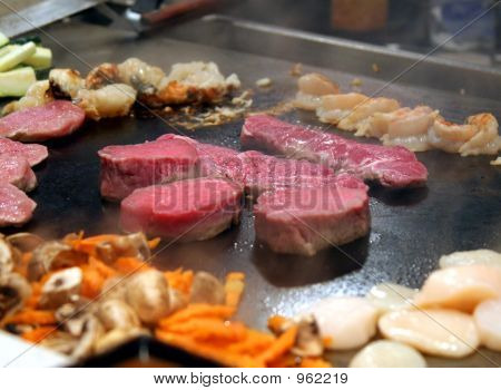 Raw Meat On A Stove
