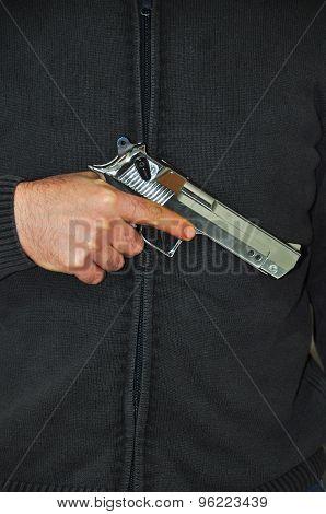 Holding a hand gun