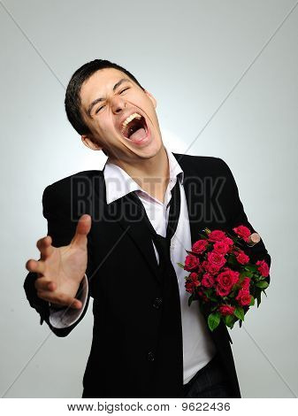 Expressions. Screaming Husband Holding Rose Flower And Vine Bottle Prepared For A Date. Gray Backgro