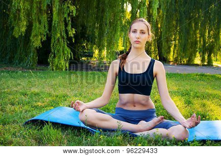 Sportswoman Meditating On A Yoga Mat