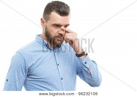 Beard-man touching face with fingers