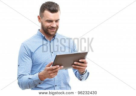 Man with beard holding tablet