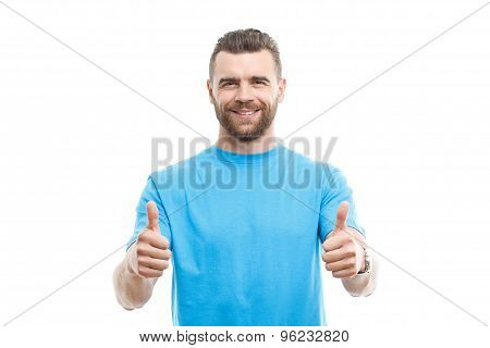 Handsome man thumbing-up on isolated background