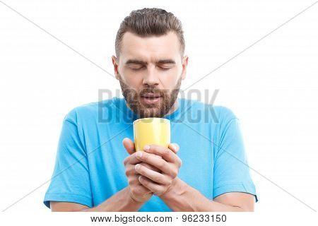 Man with beard holding cup of coffee