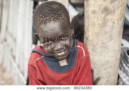 PANWEL, SOUTH SUDAN-NOVEMBER 2, 2013: Portrait of young boy of the Dinka tribe in a village in South Sudan