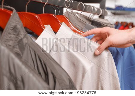 Close up of shirts on hangers