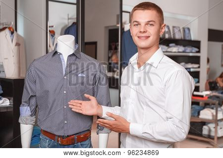 Salesman showing items in shop