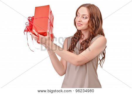 Pretty red haired woman with big present