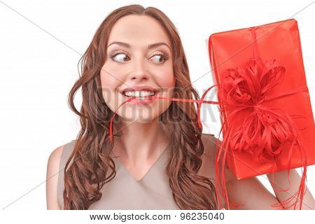 Close-up of red-haired woman holding present