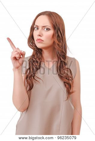 Red-haired woman pointing with index finger