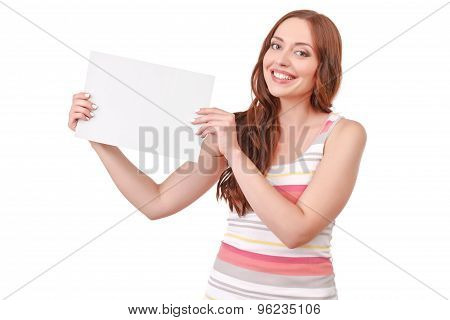 Pretty red-haired woman holding paper board