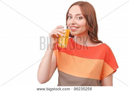 Pretty red-haired woman drinking juice