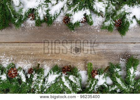 Christmas Border With Snow Covered Branches On Rustic Wooden Boards