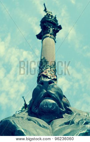 a view of the Columbus Monument in Barcelona, Spain, seen from below, with a retro effect