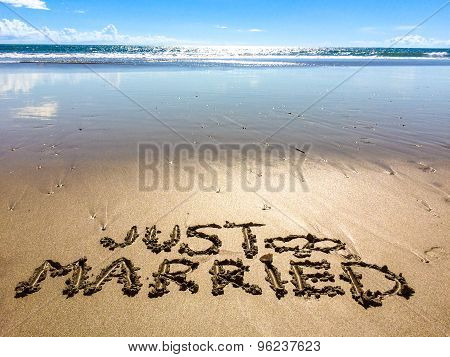 Just married written in sand