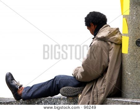 Man Sitting On A Wall