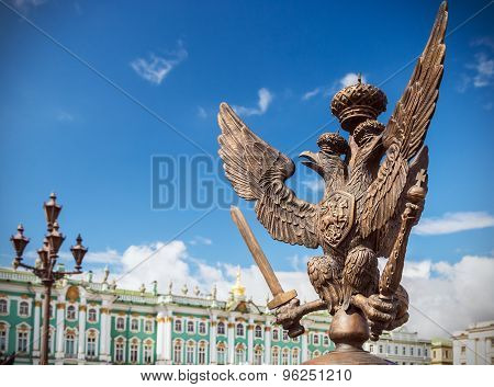 Double-headed Eagle In The Imperial Crown On The Fence Of The Alexander Column In St. Petersburg