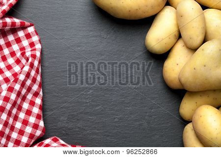 potatoes with a red checkered tablecloth