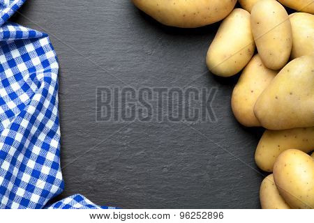potatoes with a blue checkered tablecloth