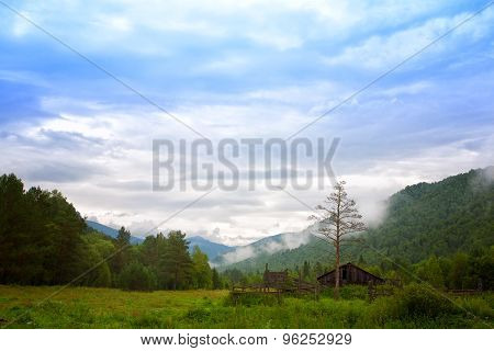 Mountain Landscape With The Old Wooden House. Altai