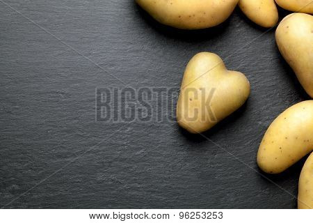 potatoes with a black graphite background