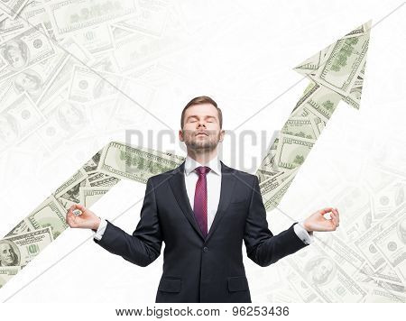 Meditative Businessman. Dollar Notes Background With The Growing Arrow Made From Dollar Notes.