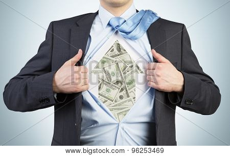 Businessman Is Tearing The Shirt On The Chest. Dollar Notes Under The Shirt. The Concept Of The Busi
