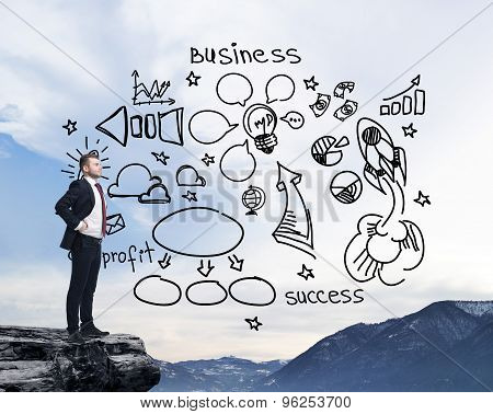 Businessman Standing On A Rock And Looking At The Flying Business Icons On The Air. Mountain Landsca