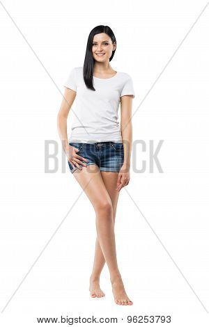 Full Length Portrait Of A Brunette Woman In A White T-shirt And A Denim Shorts. Isolated.