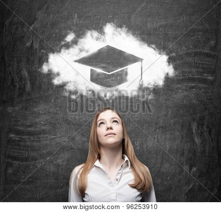 Business Woman Looking At The Cloud With Graduation Hat Over The Head. Black Chalk Board As A Backgr