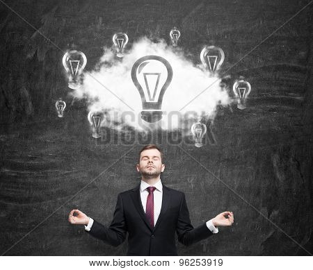 Meditative Businessman At The Cloud With Light Bulbs As A Concept Of The New Business Ideas. Black C
