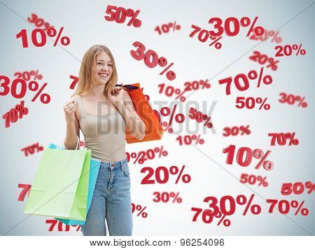 Happy Brunette With The Colourful Bags. Discount And Sale Symbols: 10% 20% 30% 50% 70%. Blue Backgro