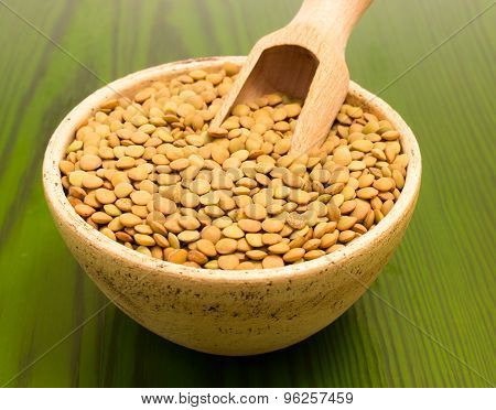 The Seeds Of Green Lentils On A Green Board