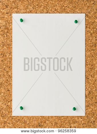 White Paper Note Sheet With Green Push Pin On Cork Board