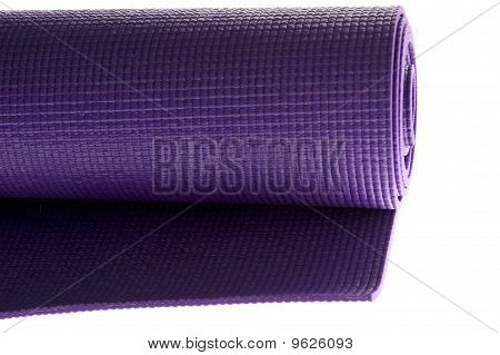 Rolled Yoga Mat On White