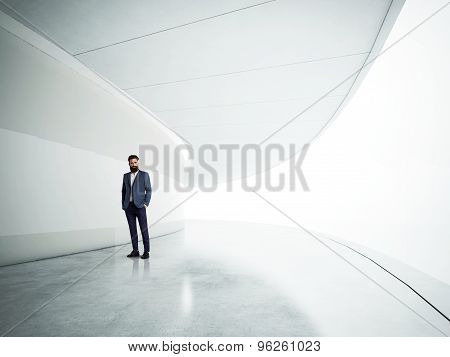 Yound bussinesman in the modern white interior.